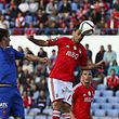 Belenenses's player Palmeira (L) vies for the ball against SL Benfica's player Jonas (R) during their Portuguese First League soccer match held at Restelo Stadium in Lisbon, Portugal, 18 April 2015. STEVEN GOVERNO/LUSA