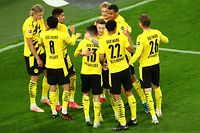 Dortmund's Portuguese defender Raphael Guerreiro (C) celebrates scoring the 2-0 goal with his team-mates during the German first division Bundesliga football match Borussia Dortmund vs 1. FC Union, in Dortmund, western Germany, on April 21, 2021. (Photo by CHRISTOF KOEPSEL / various sources / AFP) / DFL REGULATIONS PROHIBIT ANY USE OF PHOTOGRAPHS AS IMAGE SEQUENCES AND/OR QUASI-VIDEO