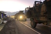 A pictures shows a Turkish military convoy in Kilis at the Syria border, on December 22, 2018. - Turkey has reinforced its military deployment near the Syrian border in the southeastern province of Kilis, local media reported, for a possible operation against Syrian Kurdish militias in coming days. (Photo by STR / DHA / AFP) / Turkey OUT