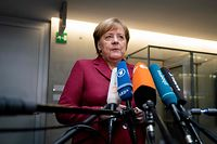 """German Chancellor Angela Merkel answers journalists' questions on the sidelines of a session of the Committee of Foreign Affairs of the Bundestag (lower house of parliament) on January 16, 2019 in Berlin. - Merkel said """"we still have time to negotiate"""" after the British parliament overwhelmingly rejected Prime Minister's deal on leaving the European Union. (Photo by Kay Nietfeld / dpa / AFP) / Germany OUT"""