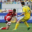 Luxembourg's David Turpel (L) and Ukraine's Taras Stepanenko fight for the ball during their Euro 2016 Group C qualifying soccer match at the Arena Lviv stadium in Lviv, Ukraine, June 14, 2015. REUTERS/Gleb Garanich