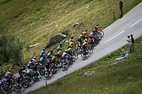 The pack rides during the third stage of the 72nd edition of the Criterium du Dauphine cycling race, 157 km between Corenc and Saint-Martin-de-Belleville on August 14, 2020. (Photo by Anne-Christine POUJOULAT / AFP)