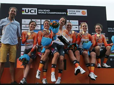Christine Majerus (r.) and teammates from Boels-Dolmans show off their gold medals at the UCI Road World Championships in Doha, Qatar.