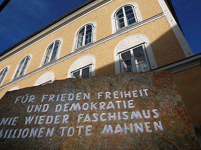 A stone outside the house in which Adolf Hitler was born, with the inscription 'For peace, freedom and democracy, never again fascism, millions of dead are a warning', is pictured in Braunau am Inn, Austria, September 24, 2012.  REUTERS/Dominic Ebenbichler/File Photo