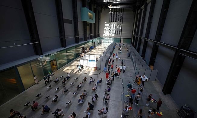 People waiting to be vaccinated at the Tate Modern in central London