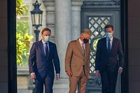 (From L) N-VA chairman Bart De Wever, King Philippe of Belgium and PS chairman Paul Magnette walk after a meeting with the King at the Royal Palace in Brussels, on July 31, 2020, regarding the formation of a new government after the federal elections of 26 May 2019. (Photo by NICOLAS MAETERLINCK / BELGA / AFP) / Belgium OUT