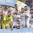 Real Madrid players celebrate their Supercup trophy after winning the second leg of the Spanish Supercup football match Real Madrid vs FC Barcelona at the Santiago Bernabeu stadium in Madrid, on August 16, 2017. / AFP PHOTO / JAVIER SORIANO