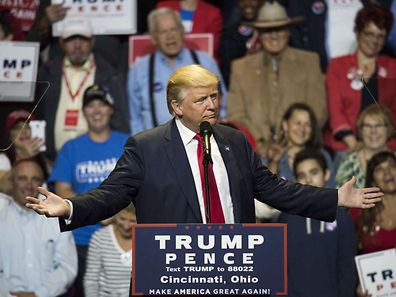 CINCINNATI, OH - OCTOBER 13: Donald Trump speaks to a crowd of attendees at U.S. Bank Arena on October 13, 2016 in Cincinnati, Ohio. Trump is campaigning in the swing state as the presidential election closes in with only 25 days until election day.   Ty Wright/Getty Images/AFP == FOR NEWSPAPERS, INTERNET, TELCOS & TELEVISION USE ONLY ==