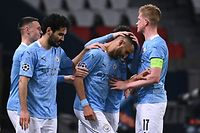 Manchester City's Algerian midfielder Riyad Mahrez (3rd-R) celebrates after scoring a goal during the UEFA Champions League first leg semi-final football match between Paris Saint-Germain (PSG) and Manchester City at the Parc des Princes stadium in Paris on April 28, 2021. (Photo by Anne-Christine POUJOULAT / AFP)