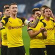 Dortmund's players react after the German first division Bundesliga football match Schalke 04 vs Borussia Dortmund on December 8, 2018 in Gelsenkirchen. (Photo by Patrik STOLLARZ / AFP) / RESTRICTIONS: DFL REGULATIONS PROHIBIT ANY USE OF PHOTOGRAPHS AS IMAGE SEQUENCES AND/OR QUASI-VIDEO