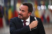 Luxembourg's Prime Minister Xavier Bettel gestures as he speaks upon arrival for a European Union Council in Brussels on July 17, 2020, as the leaders of the European Union hold their first face-to-face summit over a post-virus economic rescue plan. - The EU has been plunged into a historic economic crunch by the coronavirus crisis, and EU officials have drawn up plans for a huge stimulus package to lead their countries out of lockdown. (Photo by Francisco Seco / POOL / AFP)