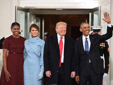 US President Barack Obama(R) and First Lady Michelle Obama(L) welcome Preisdent-elect Donald Trump(2nd-R) and his wife Melania to the White House in Washington, DC January 20, 2017.   / AFP / JIM WATSON
