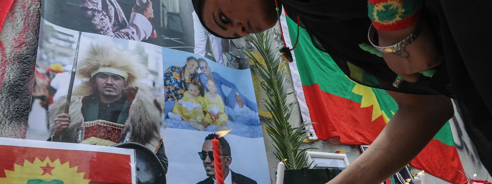 A member of the Oromo Ethiopian community in Lebanon lights a candle as she takes part in a demonstration to protest the death of musician and activist Hachalu Hundessa, in the capital Beirut on July 5, 2020. - Hundessa was shot and killed in the Ethiopian capital Addis Ababa on June 29, 2020. His death has sparked ongoing protests around the world. (Photo by ANWAR AMRO / AFP)