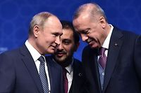 "Russian President Vladimir Putin (L) and Turkish President Recep Tayyip Erdogan (R) attend the inauguration ceremony of a new gas pipeline ""TurkStream"" on January 8, 2020, in Istanbul. - Turkish President Recep Tayyip Erdogan is hosting Russian counterpart Vladimir Putin to inaugurate a new gas pipeline, with tensions in Libya and Syria also on the agenda.The TurkStream project, which was temporarily halted during a frosty patch in Russia-Turkey relations, includes two parallel pipelines of more than 900 kilometres (550 miles). (Photo by Ozan KOSE / AFP)"
