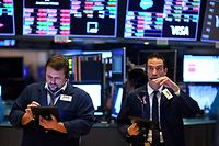 (FILES) In this file photo Traders work during the opening bell at the New York Stock Exchange (NYSE) on March 19, 2020, at Wall Street in New York City. - Wall Street opened lower on April 20, 2020 as traders grappled with a drop in oil prices to 22-year lows as the coronavirus pandemic sapped demand for energy. The Dow Jones Industrial Average was down 1.8 percent to 23,798.01 about 10 minutes into the trading session.The broad-based S&P 500 had declined 1.3 percent to 2,835.08, while the tech-rich Nasdaq had fallen 0.7 percent to 8,588.66. (Photo by Johannes EISELE / AFP)