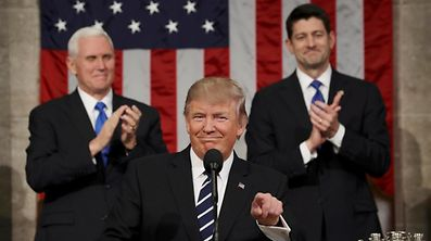 US Vice President Mike Pence (L) and Speaker of the House Paul Ryan (R) applaud as US President Donald J. Trump (C) arrives to deliver his first address to a joint session of Congress from the floor of the House of Representatives in Washington, DC, USA, 28 February 2017.  REUTERS/Jim Lo Scalzo     TPX IMAGES OF THE DAY