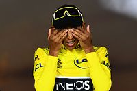 TOPSHOT - Colombia's Egan Bernal wipes his eyes celebrates his overall leader's yellow jersey on the podium of the 21st and last stage of the 106th edition of the Tour de France cycling race between Rambouillet and Paris Champs-Elysees, in Paris on July 28, 2019. (Photo by Marco Bertorello / AFP)