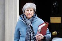 Britain's Prime Minister Theresa May leaves 10 Downing Street in London on April 3, 2019 ahead of the weekly Prime Minister's Questions (PMQs) question and answer session in the House of Commons. - Prime Minister Theresa May was to meet on Wednesday with the leader of Britain's main opposition party in a bid to thrash out a Brexit compromise with just days to go until the deadline for leaving the bloc. (Photo by Tolga AKMEN / AFP)