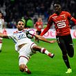 Lyon's French defender Jeremy Morel (L) vies with Rennes' Senegalese forward Ismaila Sarr during the French L1 football match between Olympique Lyonnais and Stade Rennais Football Club at the Groupama stadium in Lyon, central-eastern France on December 5, 2018. (Photo by JEAN-PHILIPPE KSIAZEK / AFP)