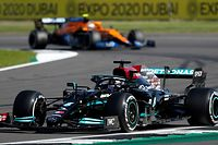 Mercedes' British driver Lewis Hamilton drives during the Formula One British Grand Prix motor race at Silverstone motor racing circuit in Silverstone, central England on July 18, 2021. (Photo by Adrian DENNIS / AFP)