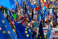 """TOPSHOT - Demonstrators hold placards and EU flags as they take part in a march by the People's Vote organisation in central London on October 19, 2019, calling for a final say in a second referendum on Brexit. - Thousands of people march to parliament calling for a """"People's Vote"""", with an option to reverse Brexit as MPs hold a debate on Prime Minister Boris Johnson's Brexit deal. (Photo by Niklas HALLE'N / AFP)"""
