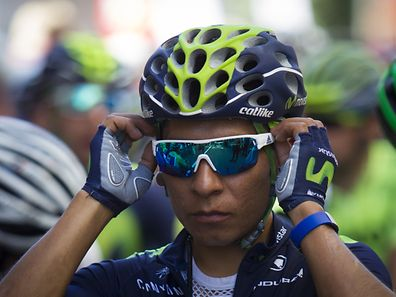 "Movistar's Colombian cyclist Nairo Quintana adjusts his glasses before the start of the 2nd stage of the 71st edition of ""La Vuelta"" Tour of Spain, a 159 km route between Ourense to Baiona on August 21, 2016. / AFP PHOTO / JAIME REINA"