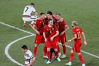 Belgium's players celebrate winning as Portugal's forward Cristiano Ronaldo (Top R) reacts after the  UEFA EURO 2020 round of 16 football match between Belgium and Portugal at La Cartuja Stadium in Seville on June 27, 2021. (Photo by Jose Manuel Vidal / POOL / AFP)