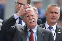 "(FILES) In this file photo taken on June 5, 2019 US National Security Advisor John Bolton arrives to attend an event to commemorate the 75th anniversary of the D-Day landings, in Portsmouth, southern England. - President Donald Trump on January 27, 2020 denied that he told his former national security advisor John Bolton that military aid to Ukraine was tied to Kiev investigating his political rivals. Trump's tweets came after The New York Times reported Sunday that Bolton alleges as much in a draft of his upcoming book.""I NEVER told John Bolton that the aid to Ukraine was tied to investigations into Democrats, including the Bidens. In fact, he never complained about this at the time of his very public termination,"" Trump tweeted in the early hours of January 27,2020. (Photo by Daniel LEAL-OLIVAS / AFP)"