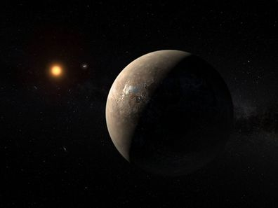 "A hand out image made available by the European Southern Observatory on August 24 2016, shows an artist's impression of the planet Proxima b orbiting the red dwarf star Proxima Centauri, the closest star to the Solar System. The double star Alpha Centauri AB also appears in the image between the planet and Proxima itself. Proxima b is a little more massive than the Earth and orbits in the habitable zone around Proxima Centauri, where the temperature is suitable for liquid water to exist on its surface.  Scientists on August 24, 2016 announced the discovery of an Earth-sized planet orbiting the star nearest our Sun, opening up the glittering prospect of a habitable world that may one day be explored by robots. Named Proxima b, the planet is in a ""temperate"" zone compatible with the presence of liquid water -- a key ingredient for life.  / AFP PHOTO / EUROPEAN SOUTHERN OBSERVATORY / M. Kornmesser"