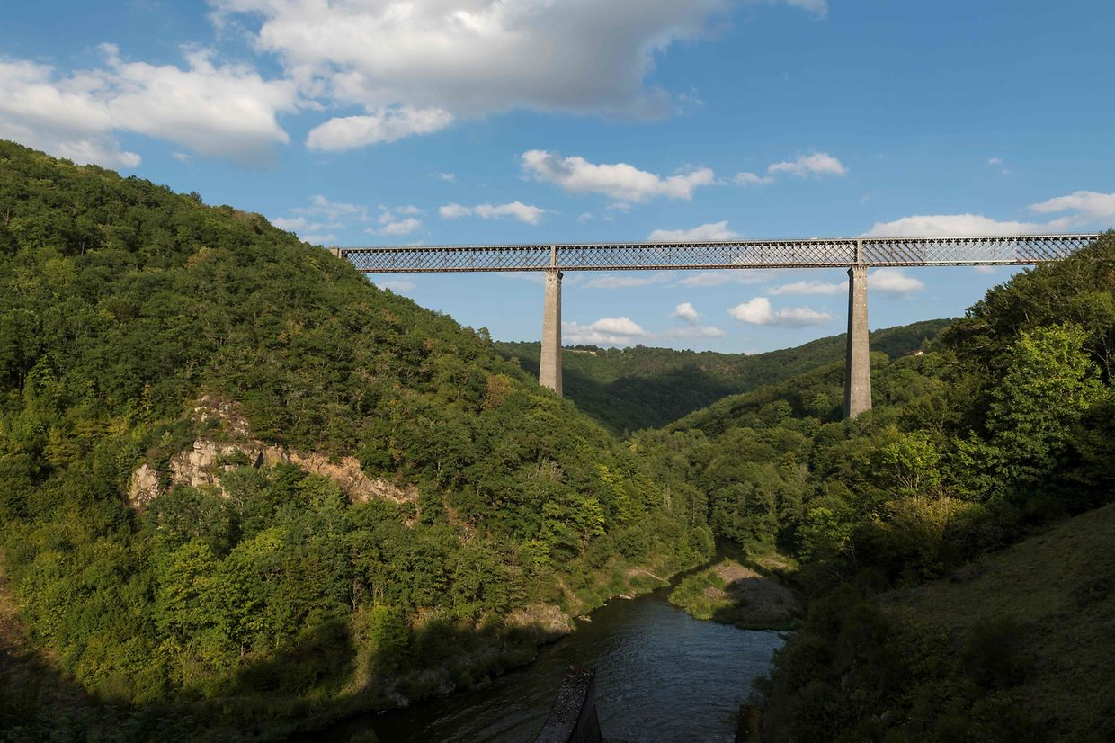 "A picture taken in Les Ancizes on August 29, 2019 shows Le Viaduc des Fades in the Combrailles, one of the monuments that will profit from the ""Loto du Patrimoine"", a lottery aiming at help restoring French heritage sites at risk, and that will feature on the new scratch tickets on sale from September 2. - The construction on the Fades Viaduct, a railway viaduct in central France, began in 1901 and was inaugurated on October 10, 1909, as the tallest bridge in the world across all categories. It was constructed using quarried granite with towers over 92m in height which remain the tallest bridge piers ever built in traditional masonry, each having a base larger than a tennis court. In 2010 it was still the tenth tallest railway viaduct in the world. (Photo by Thierry Zoccolan / AFP)"