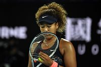 (FILES) In this file photograph taken on February 20, 2021, Japan's Naomi Osaka reacts after a point against Jennifer Brady of the US during their women's singles final match on day thirteen of the Australian Open tennis tournament in Melbourne. - Japanese star Osaka has caused a stir at Roland Garros by announcing that she will refuse to carry out any media activity at the tournament, claiming she fears the effect of them on her mental health. (Photo by Paul CROCK / AFP) / -- IMAGE RESTRICTED TO EDITORIAL USE - STRICTLY NO COMMERCIAL USE --