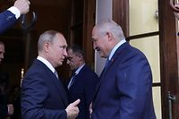 "(FILES) In this file photo taken on July 18, 2019 Russian President Vladimir Putin sees Belarus' President Alexander Lukashenko off following their talks in Saint Petersburg. - Russian President Vladimir Putin backed embattled Belarusian leader Alexander Lukashenko at talks on September 14, 2020, saying he was sure the Belarusian strongman would see through proposed reforms. ""I'm sure that considering your experience... work in this direction will be organised at the highest level and allow the development of the country's political system to reach new heights,"" Putin said as they met at his residence in the Black Sea city of Sochi. (Photo by Mikhail KLIMENTYEV / SPUTNIK / AFP)"
