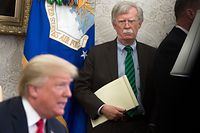 National Security Adviser John Bolton stands alongside US President Donald Trump as he speaks during a meeting with NATO Secretary General Jens Stoltenberg in the Oval Office of the White House in Washington, DC, May 17, 2018. / AFP PHOTO / SAUL LOEB