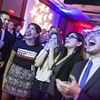 WASHINGTON, DC - NOVEMBER 06: People react to 2018 midterm election results during a DCCC election watch party at the Hyatt Regency on November 6, 2018 in Washington, DC. Today millions of Americans headed to the polls to vote in the midterm elections that will decide what party will control the House of Representatives and the U.S. Senate.   Zach Gibson/Getty Images/AFP == FOR NEWSPAPERS, INTERNET, TELCOS & TELEVISION USE ONLY ==