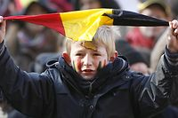 A boy waves a small Belgian flag during the 'March for Unity', a march to support Belgium's unity, 18 November 2007 in Brussels. 165 days after the federal elections of June 2007 demonstrators urge leading politicians to find a solution to form a government without breaking up the country. Several thousand people demonstrated 18 November in Brussels in favour of Belgian unity as a political crisis threatened to tear the country apart into its Dutch and French-speaking communities.   AFP PHOTO / BELGA / BENOIT DOPPAGNE