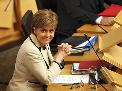 Scotland's First Minister Nicola Sturgeon listens in the debating chamber of the Scottish Parliament at Holyrood in Edinburgh, Scotland, Britain June 28, 2016.  REUTERS/Scott Heppell