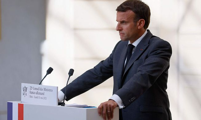 French President Emmanuel Macron looks on during a press conference upon the 22nd German-French Ministerial Council videoconference at the Elysee presidential palace in Paris, on May 31, 2021.