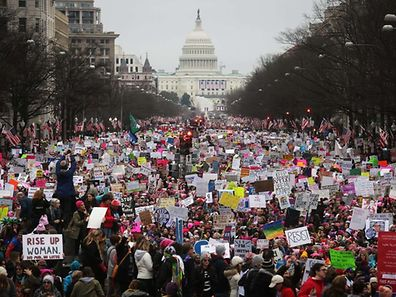 WASHINGTON, DC - JANUARY 21: Protesters walk up Pennsylvania Avenue during the Women's March on Washington, with the U.S. Capitol in the background, on January 21, 2017 in Washington, DC. Large crowds are attending the anti-Trump rally a day after U.S. President Donald Trump was sworn in as the 45th U.S. president.   Mario Tama/Getty Images/AFP == FOR NEWSPAPERS, INTERNET, TELCOS & TELEVISION USE ONLY ==