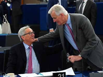 EU Commission president Jean-Claude Juncker talks with European commission member in charge of Brexit negotiations with Britain, Frenchman Michel Barnier