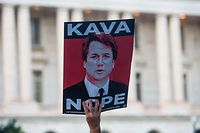 Protesters hold up signs during a rally near Capitol Hill against the confirmation hearing for Judge Brett Kavanaugh to be an Associate Justice on the US Supreme Court in Washington, DC, on September 4, 2018. - President Donald Trump's newest Supreme Court nominee Brett Kavanaugh is expected to face punishing questioning from Democrats this week over his endorsement of presidential immunity and his opposition to abortion. (Photo by Andrew CABALLERO-REYNOLDS / AFP)