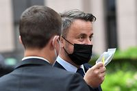 Luxembourg's Prime Minister Xavier Bettel departs at the end of a two-day European Union (EU) summit at The European Council Building in Brussels on June 25, 2021. - . (Photo by JOHN THYS / various sources / AFP)