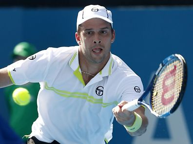 Luxembourg's Gilles Muller hits a return against Viktor Troicki of Serbia in their men's singles semi-final match at the Sydney International tennis tournament