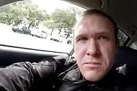 "This image grab from a self-shot video that was streamed on Facebook Live on March 15, 2019 by the man who was involved in two mosque shootings in Christchurch shows the man in his car before he entered the Masjid al Noor mosque. - A ""right-wing extremist"" armed with semi-automatic weapons rampaged through two mosques in the quiet New Zealand city of Christchurch during afternoon prayers on March 15, killing 49 worshippers and wounding dozens more. (Photo by Handout / HANDOUT / AFP) / -----EDITORS NOTE --- RESTRICTED TO EDITORIAL USE - MANDATORY CREDIT ""AFP PHOTO / HANDOUT"" - NO MARKETING - NO ADVERTISING CAMPAIGNS - DISTRIBUTED AS A SERVICE TO CLIENTS - NO ARCHIVES"