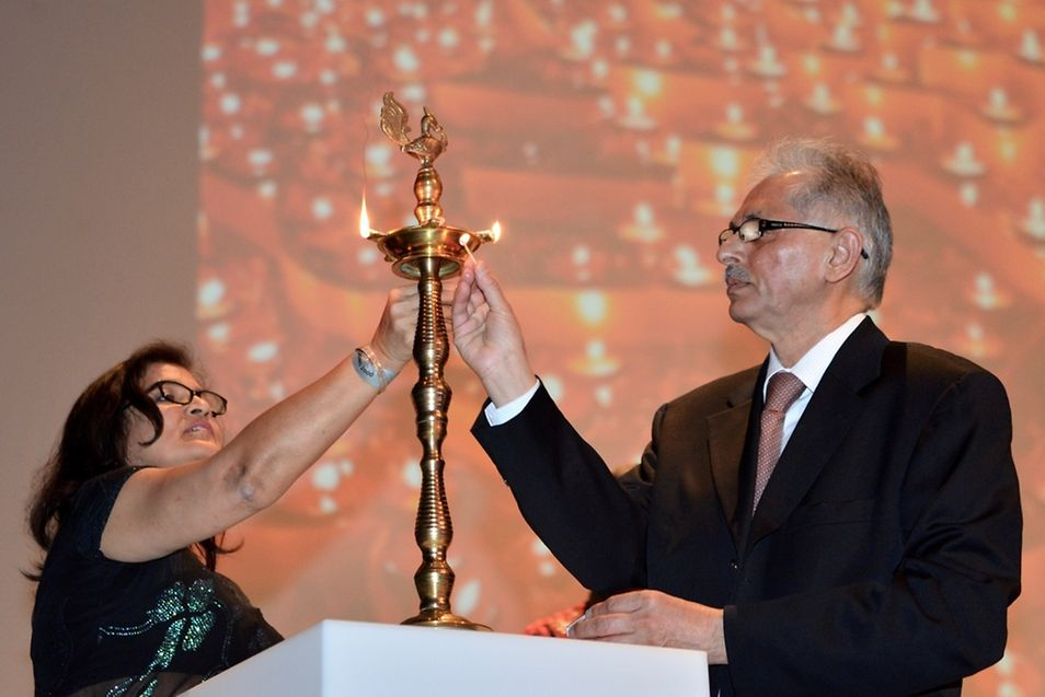 IBCL president Sudhir Kohli and wife Anita light a candle