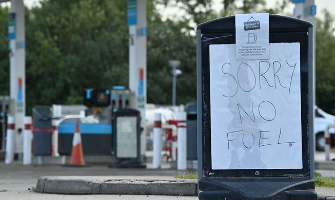 A sign informs motorists that there is no fuel at a petrol station near Tonbridge, southeast England, on Monday