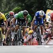 Slovakia's Peter Sagan (Front C-L) sprints in the last meters to win ahead of Italy's Sonny Colbrelli (R) and Belgium's Philippe Gilbert (2ndR) the fifth stage of the 105th edition of the Tour de France cycling race between Lorient and Quimper, western France, on July 11, 2018.  / AFP PHOTO / Jeff PACHOUD