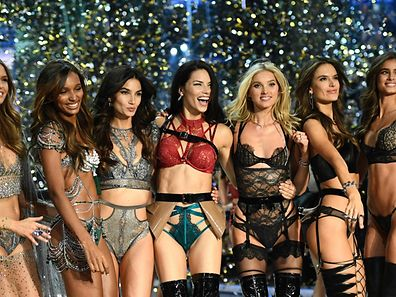 CORRECTION - Victoria's Secret Angels (fromL) Danish model Josephine Skriver, US model Jasmine Tookes, US model Lily Aldridge, Brazilian model Adriana Lima, Swedish model Elsa Hosk, Brazilian model Alessandra Ambrosio and US model Taylor Hill cheer during the 2016 Victoria's Secret Fashion Show at the Grand Palais in Paris on November 30, 2016.  / AFP PHOTO / Martin BUREAU / RESTRICTED TO EDITORIAL USE / �The erroneous mention[s] appearing in the metadata of this photo by Martin BUREAU has been modified in AFP systems in the following manner: SWEDISH MODEL ELSA HOSK instead of BRITISH MODEL LILY DONALDSON. Please immediately remove the erroneous mention from all your online services and delete it from your servers. If you have been authorized by AFP to distribute it to third parties, please ensure that the same actions are carried out by them. Failure to promptly comply with these instructions will entail liability on your part for any continued or post notification usage. Therefore we thank you very much for all your attention and prompt action. We are sorry for the inconvenience this notification may cause and remain at your disposal for any further information you may require.�