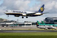 """(FILES) This file photo taken on September 21, 2017 shows a Ryanair plane landing at Dublin Airport on September 21, 2017.  Ryanair on December 20, 2017 hailed a """"positive and successful"""" meeting with pilots' representatives, following unprecedented talks as the Irish no-frills airline takes the first steps towards union recognition. / AFP PHOTO / Paul FAITH"""