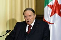 (FILES) In this file photo taken on April 10, 2016, Algerian President Abdelaziz Bouteflika meets with the French prime minister at his residence during an official visit in Zeralda, a suburb of the capital Algiers. - The confirmation on February 10, 2019 that Algeria's ailing President Bouteflika would contest a fifth term sparked a series of protests in the North African country. (Photo by Eric FEFERBERG / AFP)