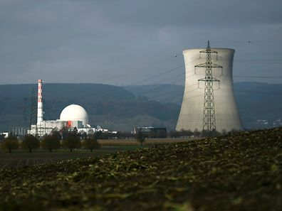 """(FILES) This file photo taken on November 13, 2016 shows Leibstadt nuclear power plant near in Leibstadt, Northern Switzerland.  Swiss voters will head to the polls on November 28, 2016 to decide whether or not to speed up the process of phasing out the country's nuclear power plants. Switzerland has already vowed to do so but a """"yes"""" vote would force three of its five reactors to close next year.  / AFP PHOTO / FABRICE COFFRINI"""